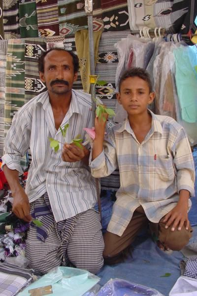 Father and son in a market | Yemeni People | Yemen