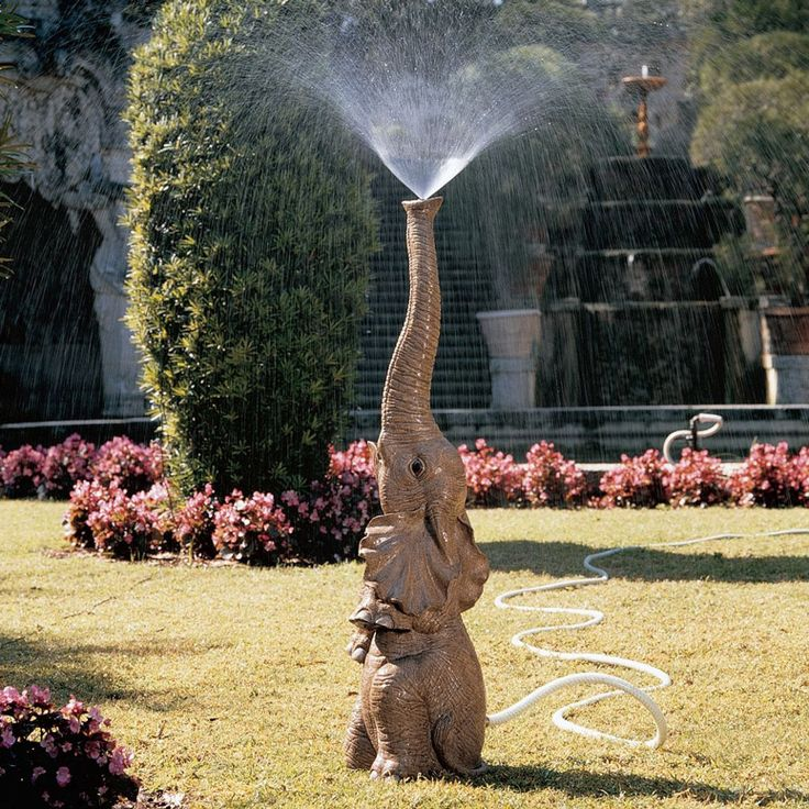 Elephant Lawn Sprinkler!!  I have one too!!  Leave it to my Sprinkler Collector husband.