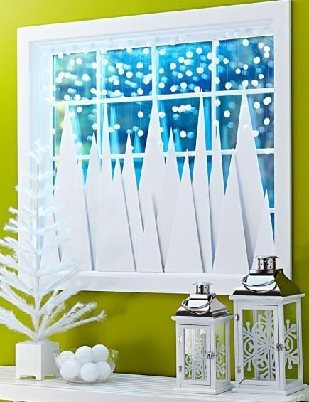 A flurry of snowflakes floats about a forest of pines in this DIY window decoration. How-to: http://www.midwestliving.com/holidays/christmas/4-ideas-for-winter-window-decorating/?page=2