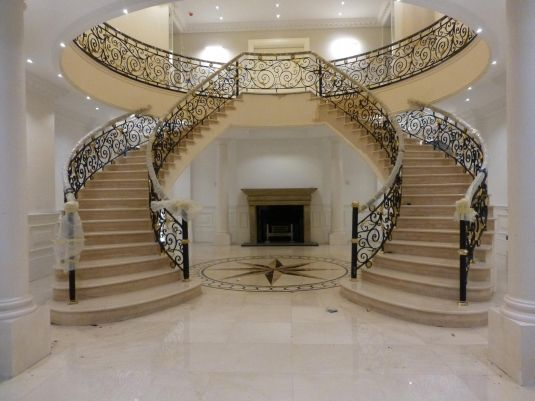 wrought iron winding staircase with brass ornaments