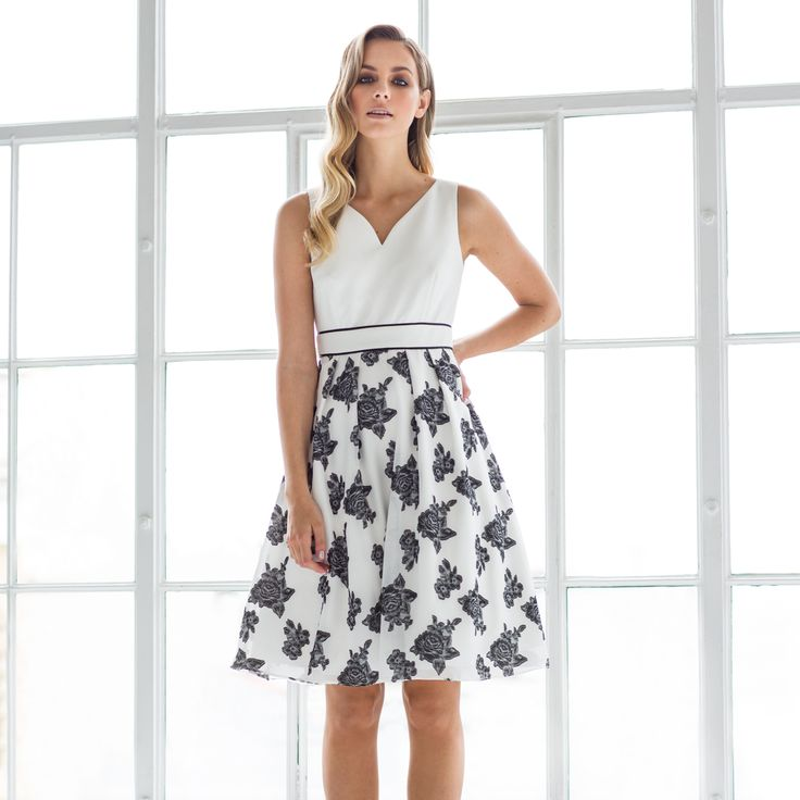 """The Zoe Dress is a beautifully flattering style. The tailored bodice and sleek v-neckline are an elegant touch whilst the waist is cinched in for the perfect fit. """"Delicate, sheer and textured, the Zoe Dress showcases both softness and structure."""""""