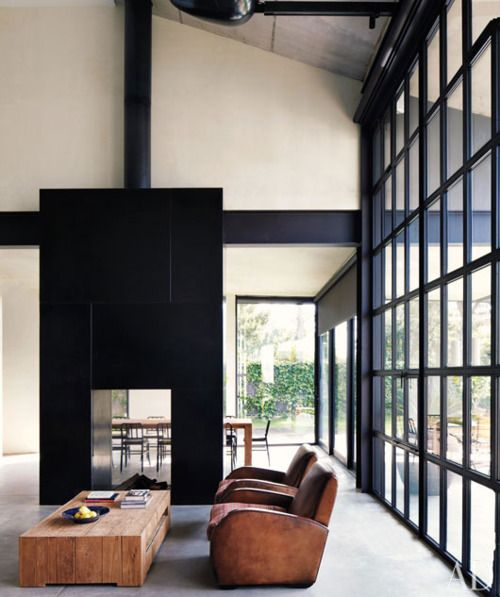 Love the floor to ceiling window, white and black contrast, and the immensity of the room paired with small furniture