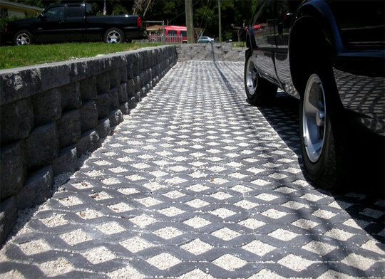 Presto Geosystems, Filterpave, Turfstone Permeable Concrete Pavers (pictured), Filtercrete Pervious Concrete, VAST Composite Pavers.  http://www.apartmenttherapy.com/green-your-driveway-with-permeable-pavers-170074
