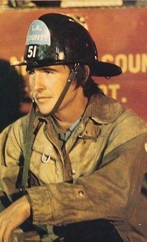Randolph Mantooth as John Gage in fire gear