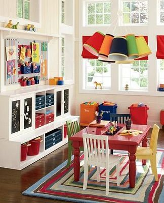 A Design for Life...: Playrooms - pinboard over storage - that light!