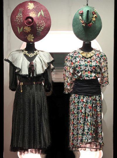 On the left wearing:1970s Nina Ricci silk dress, 1970s leather belt, 1980s golden necklace, 1963 Florentine straw hat.   Outfit on the right:1980s Heriet Selling silk dress, 1980s golden necklace, 1960s Florentine straw hat.