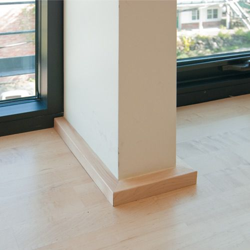 The low profile of the 1×1 base often works much better with window systems – a taller base trim would seem less deliberate and clunky compared to the sleek, minimal window frames.
