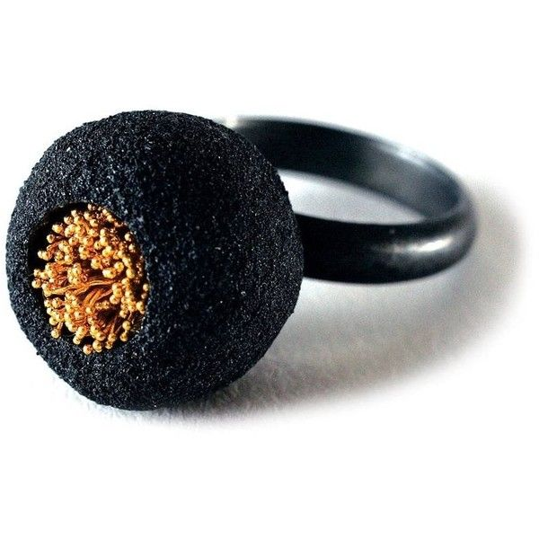 Arata Fuchi Black Ball Ring. Normally I don't like blacks, but the form and golden middle is so fine