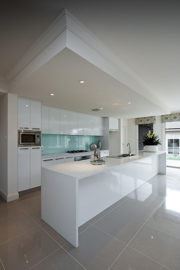 Dechellis Monaco. Love the dropped ceiling, blue glass splashback and tonnes of cupboards