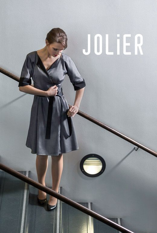 She just turned her JOLIER dress! -Just like that! | black / grey | two colors | timeless | priceless | transformable | smart | finnish | sustainable | ethical | changing fashion | reversible Eleanor instock | jolier.com | since 2008
