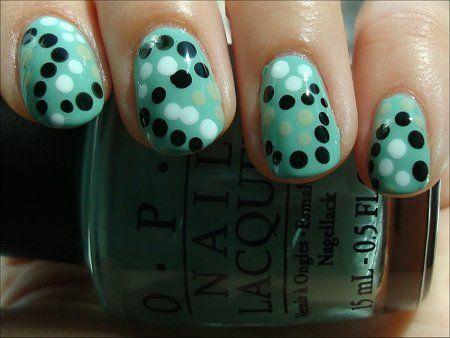 Green nail polish with dotting tool