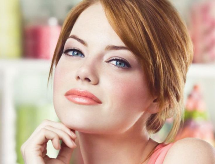 Emma stone...go to makeup trends for fair-skinned and redheads.  She is wearing Revlons Lip butter in Peach Parfait. I bought it and it's pretty fab. More shimmery than expected. and More neutral than the pic.                                                                                                                                                                                 More