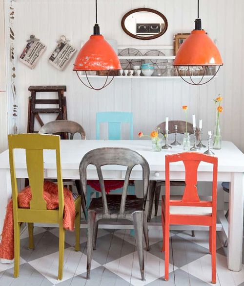 love the different colors and types of chairs with bright light fixtures