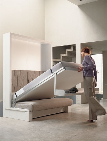 Wall bed... want mine!! I wouldn't have to clean under my bed anymore :)