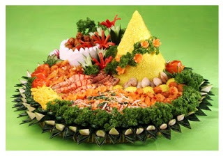 Tumpeng Rice - Tumpeng, is a rice served in the shape of a conical volcano, usually with rice colored yellow using turmeric. It is an important part of ceremony in Java. Tumpeng served in landmark events such as birthday, moving house, or other ceremonies.