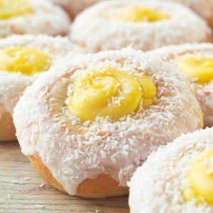 """koleboller – not just for kids!  Skoleboller, or skolebrød, translates into """"school buns"""" or """"school"""" bread, and are sweet cardamom buns, filled with a vanilla custard in the middle, decorated with confectioners sugar glaze and shredded coconut."""