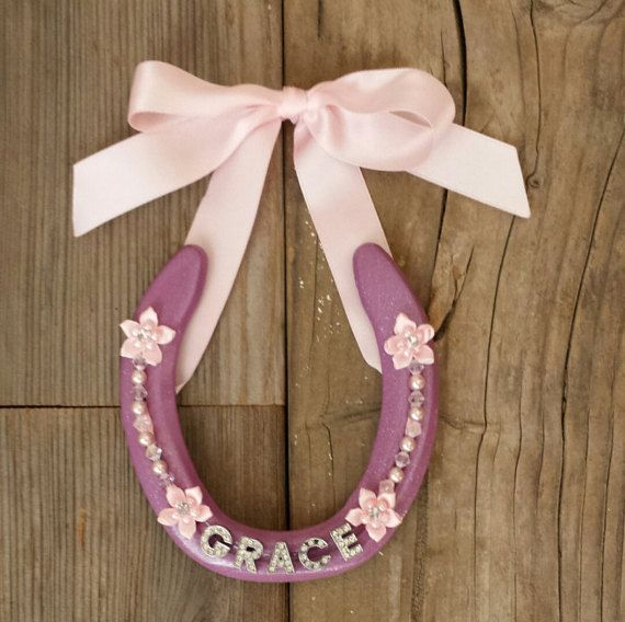 Check out this item in my Etsy shop https://www.etsy.com/listing/258370230/decorated-horseshoes-personalized-name