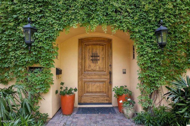 Mediterranean Front Door with Kwik Set 980/985 Deadbolt, exterior brick floors, exterior tile floors