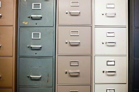 Just because a metal filing cabinet doesn't fit in with the rest of your home of office, don't let it get in your way of utilizing your storage space.