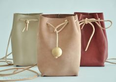DIY leather bag Purse by // Between the Lines // tutorial link : http://apairandasparediy.com/2013/07/diy-leather-pouch.html