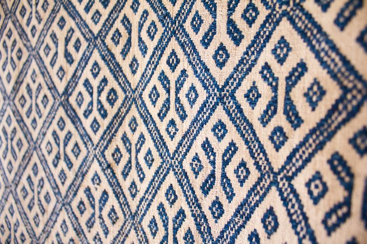 Heritage textile featuring diamond and butterfly motifs, hand woven and dyed using indigo. From Fibre2Fabric collection at Ock Pop Tok
