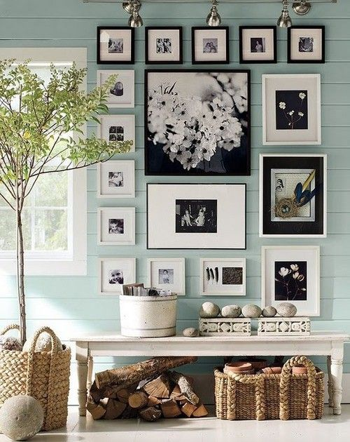 Really liking this picture wall with all different types of sized frames. I especially like the black & white pictures. Possibly in the Master bedroom??