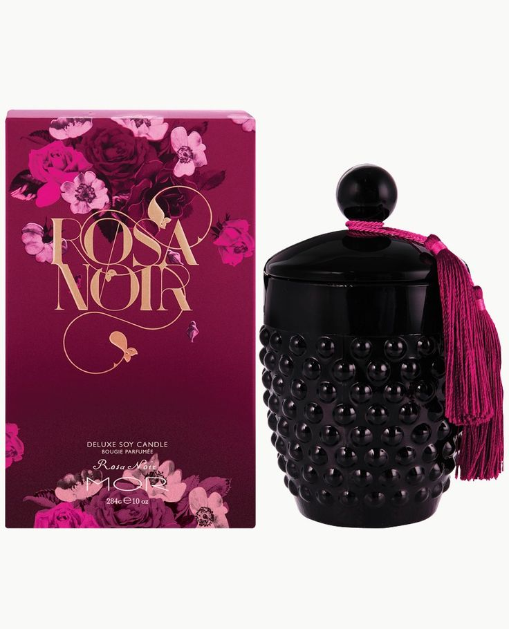 Rosa Noir Deluxe Soy Candle - Hypnotic rays of floral elegance are entwined with the sensual velvety notes of Sandalwood, Musk and Tonka bean to create this alluring scented Candle. Encased in a sleek glass hobnail vessel and complete with its own tasselled snuffer, the flickering candle light and captivating floral fragrance will add ambience to any room.