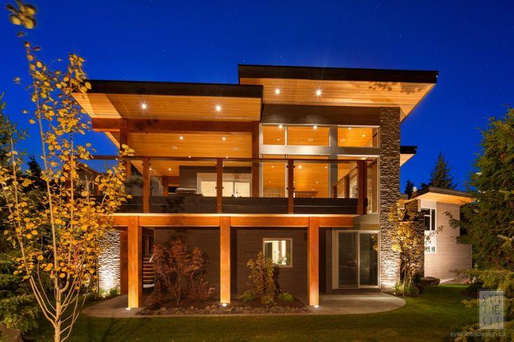 Like midcentury sloping roof, huge windows, stone feature