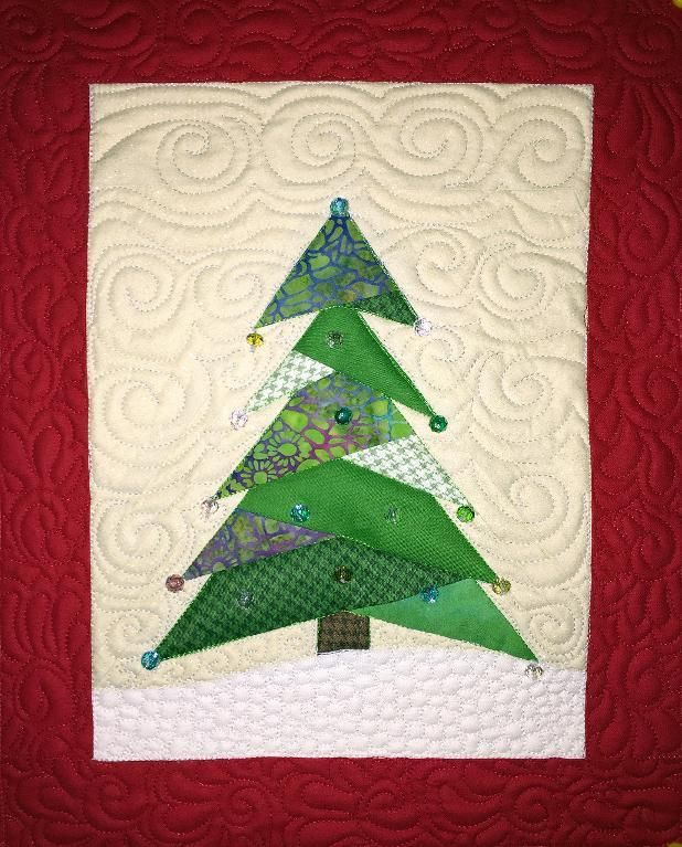 Looking for your next project? You're going to love Mini Christmas Tree Quilt by designer Debra Clutter. - via @Craftsy