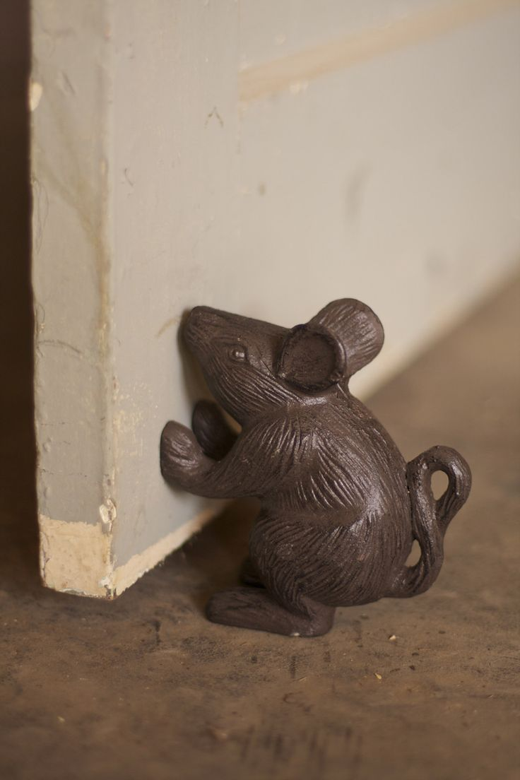 """This petite little mouse, made from cast iron and featuring charming details, will always stand ready to prop open your door or prop up your books. 4½"""" x 5""""t"""