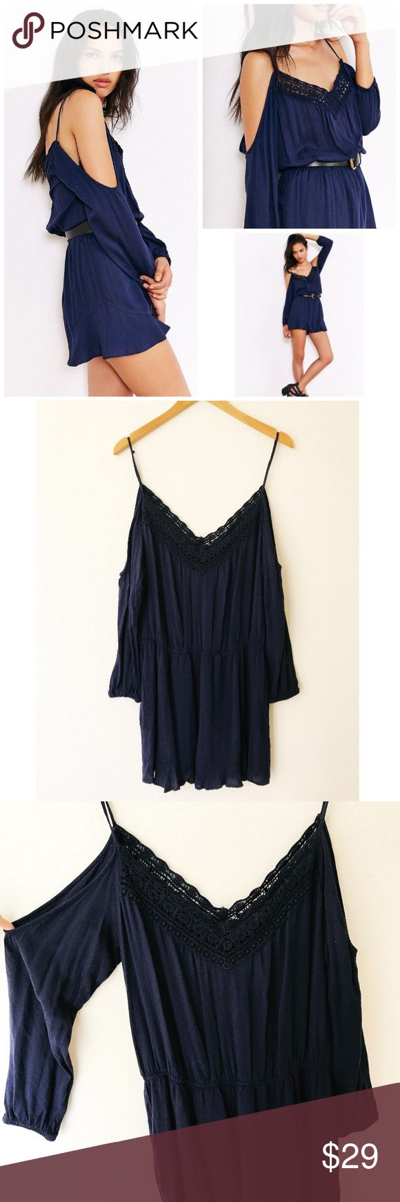 UO Ecote Navy Blue Open Shoulder Romper Very good preowned condition. Navy blue romper with police detail around the neckline, ruffled hem Shorts, open boulder Shoulder style with long sleeves. Elastic waist and fully lined. Urban Outfitters Pants Jumpsuits & Rompers