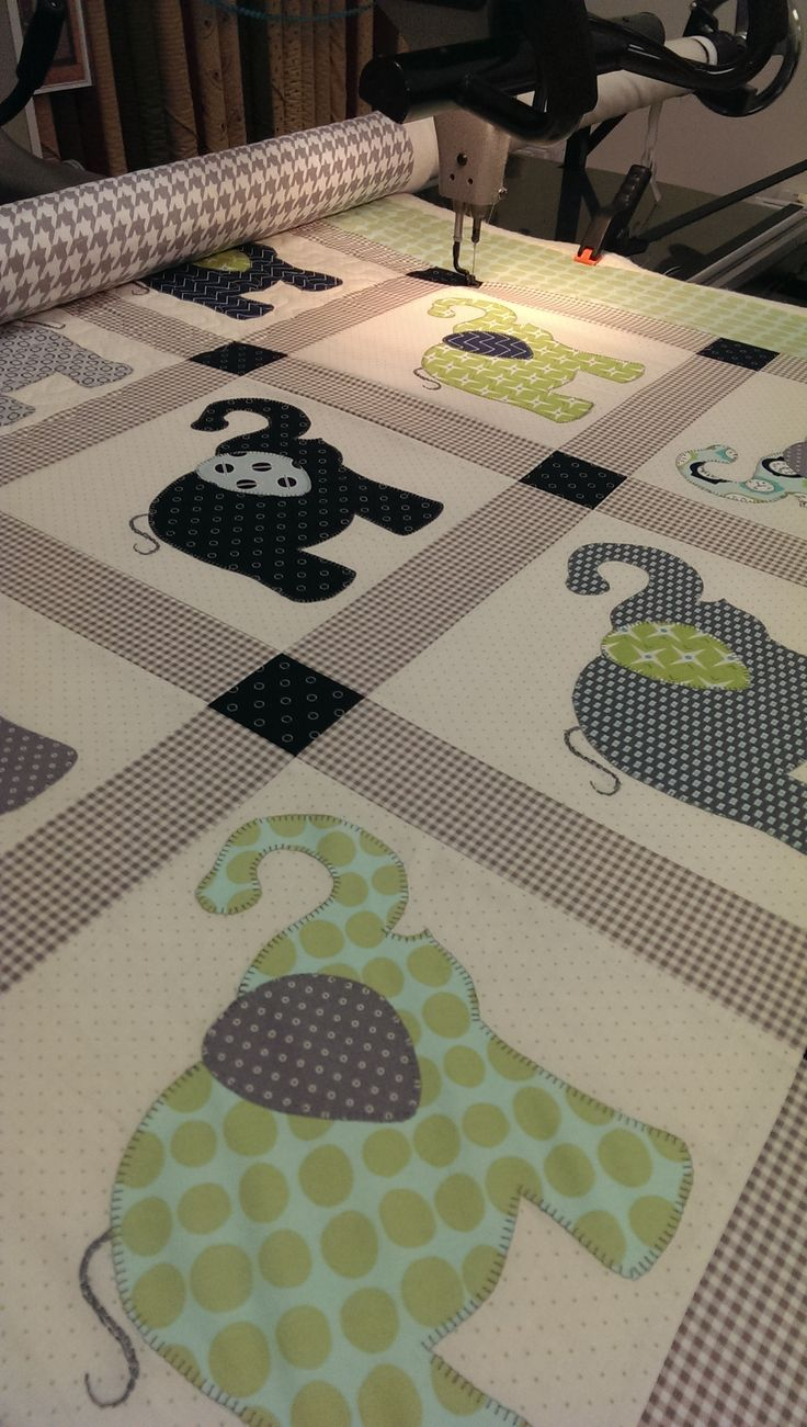 This quilt was made by Sharon Budge using the elephant applique pattern from…