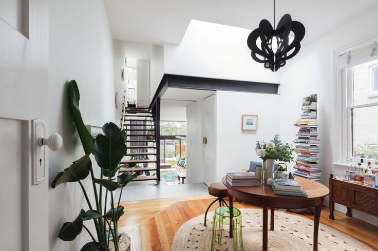Book staples in a sustainable house with a big plant a black lamp