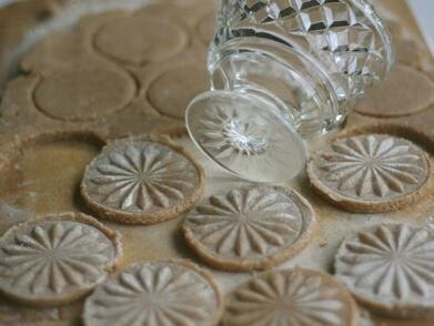 How clever!  This is a great idea for rolled dough cookies.  Use a pretty glass to make an imprint on your cookies.  Dip the bottom of the glass into some flour, then press the glass into the cookie dough to create an imprint.  Use a pastry brush to remove the excess flour before you bake.