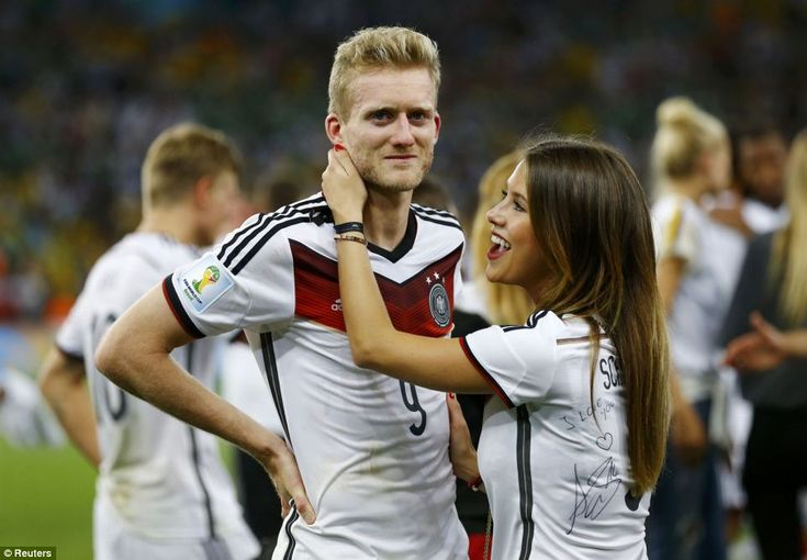 Proud moment: Andre Schuerrle is congratulated by girlfriend Montana Yorke, who wore a shirt he had signed
