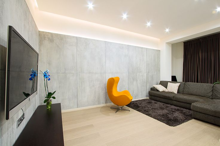 Fresh Orange Wing Chair Placed under Modern Studio Apartment Living Room Among Recessed Lamps As Illumination