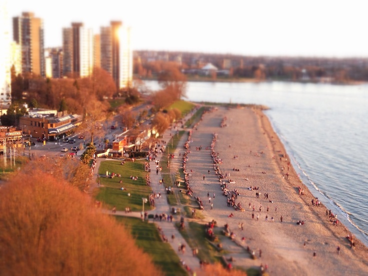 English Bay, Vancouver BC Canada (view includes Boathouse Restaurant, Cactus Club Cafe, beach, west end)