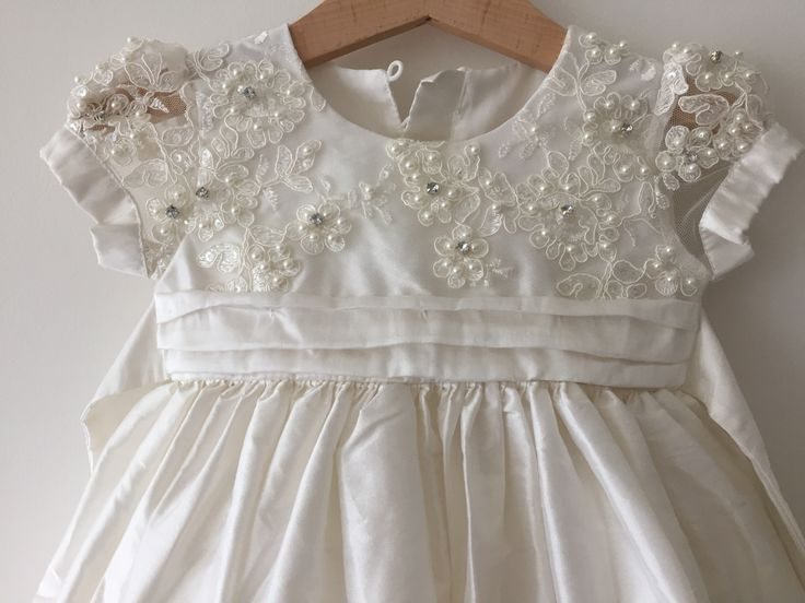 Beautiful lace bodice with diamond accents and little puff sleeves | Bisou Baby #christeningdress #babygirl #christeningoutfit #bisoubaby