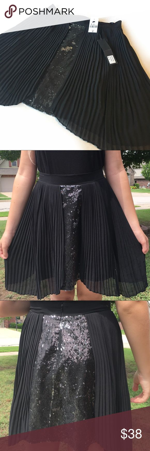 """LF Kiwi Tucker two toned black sequin skirt Sold at LF stores. Kiwi Tucker two toned sequin and pleated black skirt. Longer on the sides, zipper closure in back. Measured laying flat waist is approximately 13.5"""". Length in front 16"""", length on the sides 19"""". LF Skirts"""