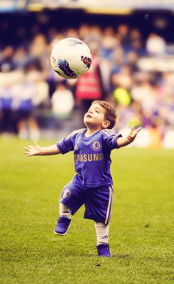 Little kids playing soccer is just about the best thing ever.