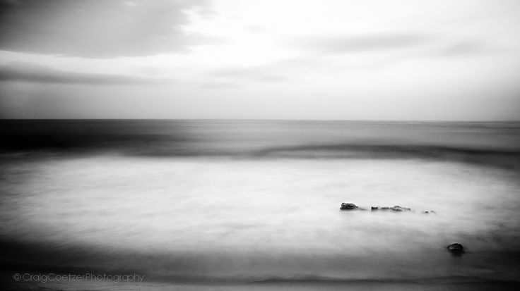 Incoherent Beauty - This is a minimalist long exposure shot of a restless ocean while an intense sunset gracefully unfolded over the horizon. This photo was taken in Kwazulu Natal, South Coast, South Africa on the 2nd of April 2014.  EXIF data (30 sec at f11, ISO 100) at 105mm