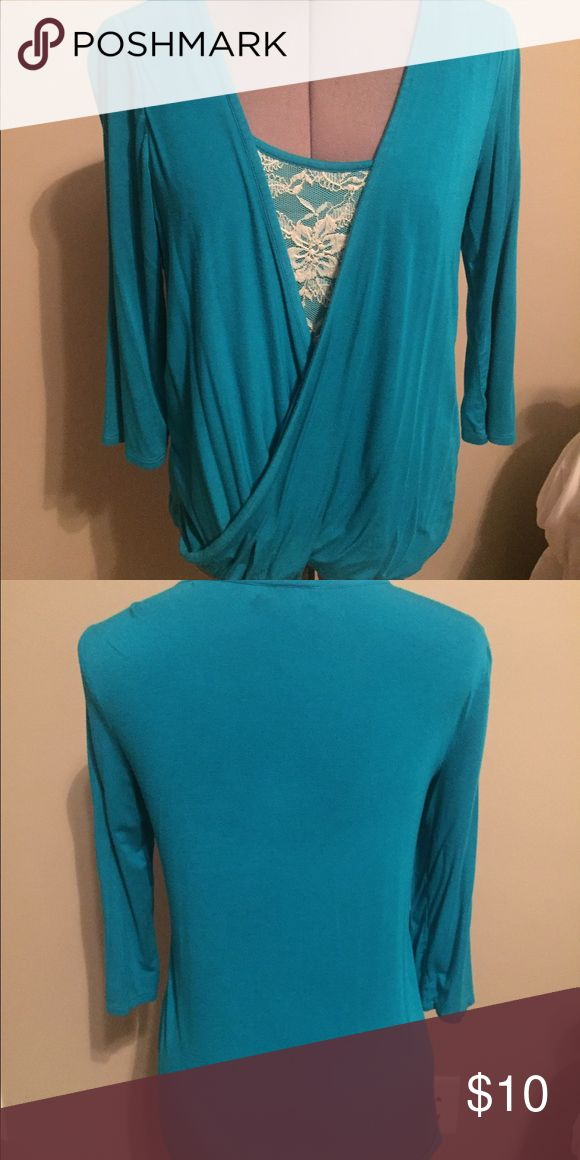 Beautiful turquoise shirt! This shirt is absolutely beautiful!!  In great condition Tops Crop Tops