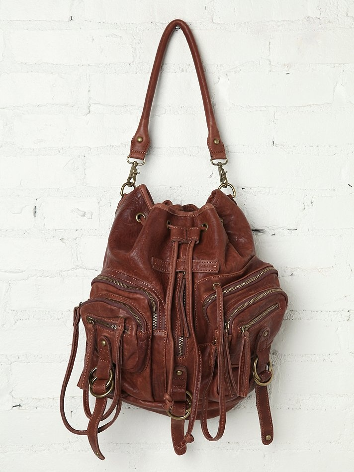 Freepeople ❤ Distressed leather convertible backpack with four utility pocket compartments on the front with zipper pulls