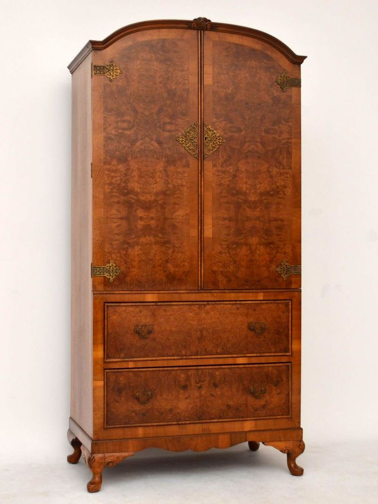 This small compact walnut cupboard on chest has a wonderful shape & could be used in a variety of areas in the home. It's antique Queen Anne style & has two cupboards on the top half, with two shelves inside. There are two drawers below & it sits on carved shaped feet. The top doors are burr walnut, with crossbanding plus beautiful brass hinges & escutcheons. The drawers too are burr walnut with original brass handles. Dates around 1930s period.