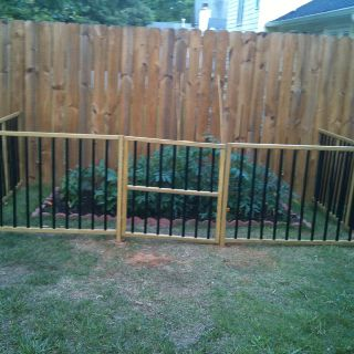 PVC pipe spray painted black to imitate iron...protect your garden from your kids and dogs