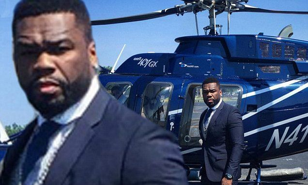 Rapper 50 Cent poses with helicopter after reaching bankruptcy deal
