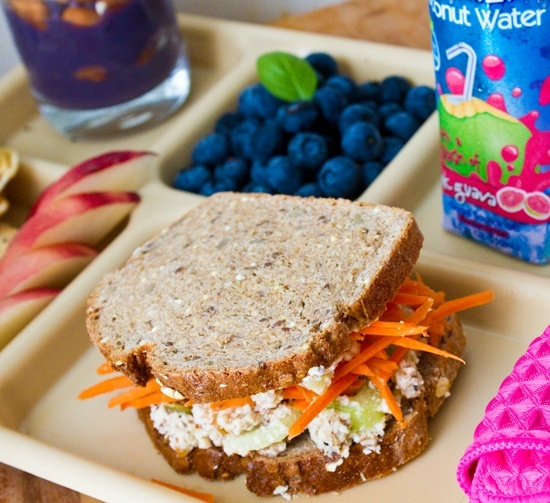 For your kids school lunch, youll want to load up on protein, fiber and healthy fats - which will keep your kid satisfied, increase his/her metabolism and provide important nutrients. Go with 100% whole-grain bread, with turkey, chicken or roast beef sliced by the butcher and some swiss or cheddar for a shot of calcium.. Itll give your child more energy and a sharper mind for the rest of the day. Or PB with PURE fruit jelly. Add carrot sticks, celery sticks, or apple slices as a si