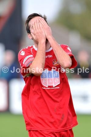 Sam Newson of Needham Market F.C misses the goal