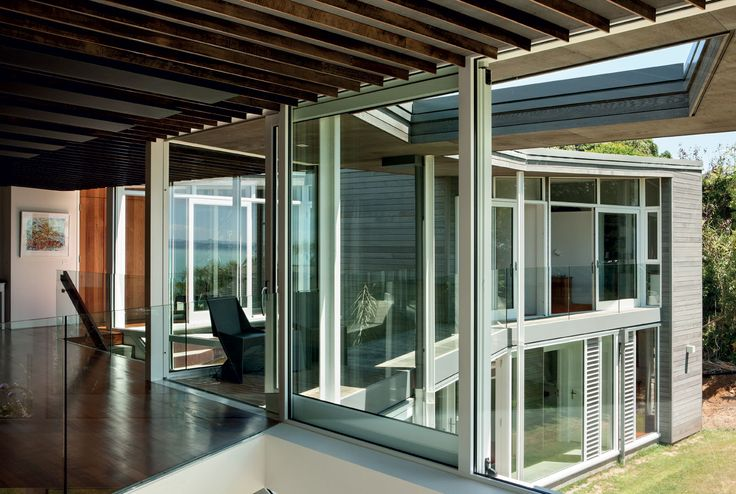 Ample glazing, coupled with voids in the roof plane, allows for natural light and solar gain. Infrared panels in the ceiling are an unobtrusive mechanical heating device.