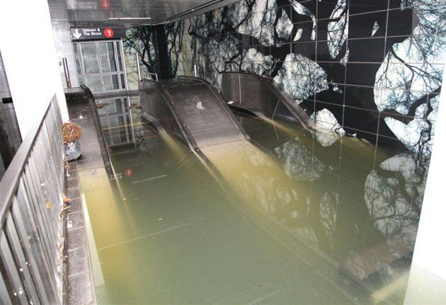 This Oct. 30, 2012, photo provided by New York's Metropolitan Transportation Authority (MTA) shows a flooded escalator in the South Ferry station of the No. 1 subway line, in lower Manhattan, after Su